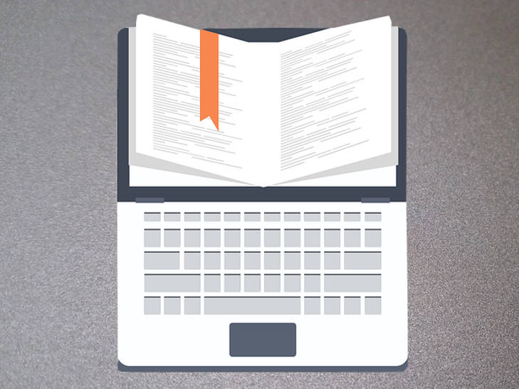 Laptop with open book to represent a book marketing plan.