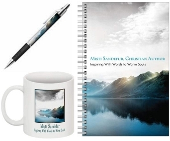 Notebook, pen and coffee cup with a mountain background and Christian author Misti Sandefur text.